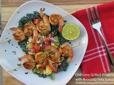 Chili lime grilled prawns and avocado feta salsa on a plate