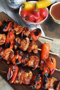 BBQ Bacon shrimp skewers on cutting board