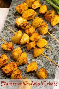 Barbecue potato kebabs on stone tray