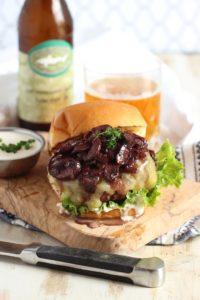 Beef bourguignon burger on cutting board