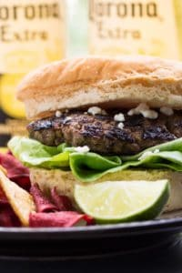 Carne asada mexican burger with a lime and chips
