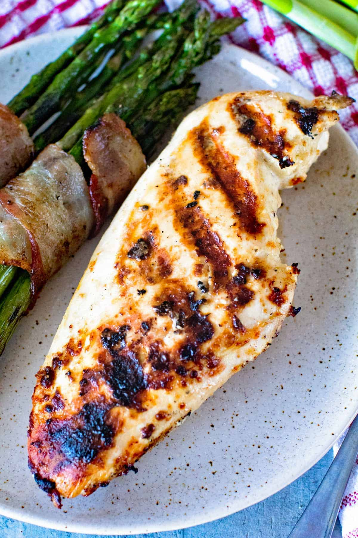 Caesar Grilled Chicken Breast and bacon wrapped asparagus on plate