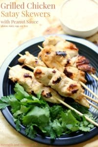 Grilled chicken satay skewers on plate
