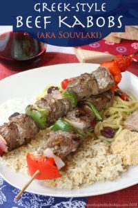 Greek style beef kabobs and rice on plate