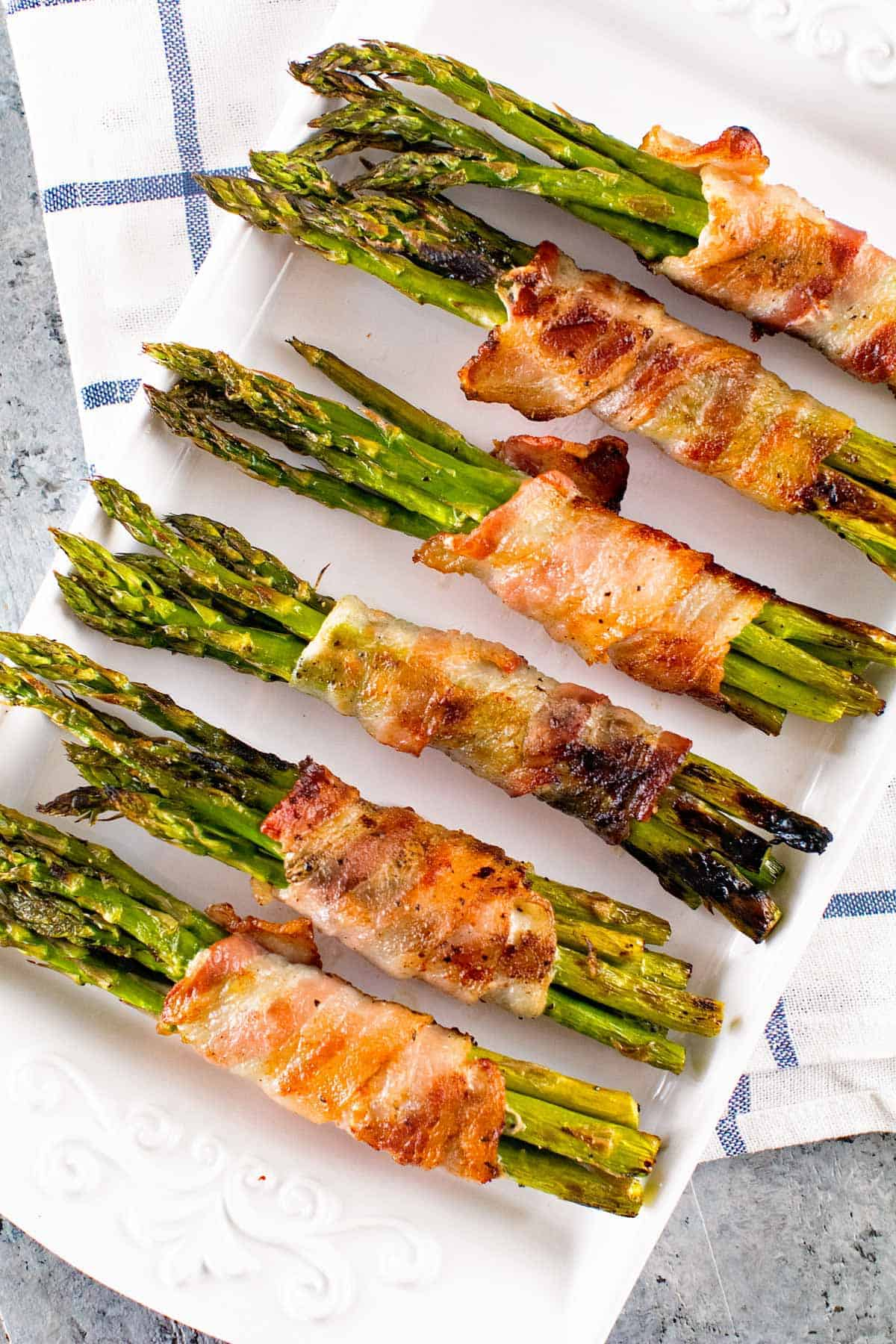 Grilled Bacon Wrapped Asparagus ~ Easy, Grilled Side Dish! Crispy Bacon Wrapped Around Tender Asparagus Spears!