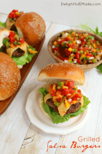Grilled salsa burgers on white table