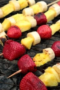 Strawberry, pineapple, and banana skewers on the grill