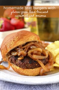 Homemade brat burger with caramelized onions and chips on a plate