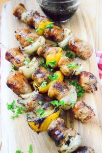 Grilled hot italian sausage kabobs on cutting board