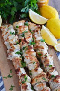 Lemon garlic chicken skewers on cutting board