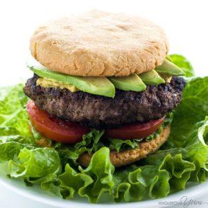 Hamburger with avocado, tomato, and lettuce
