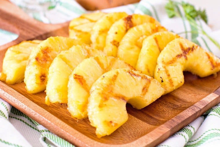 grilled pineapple on brown cutting board