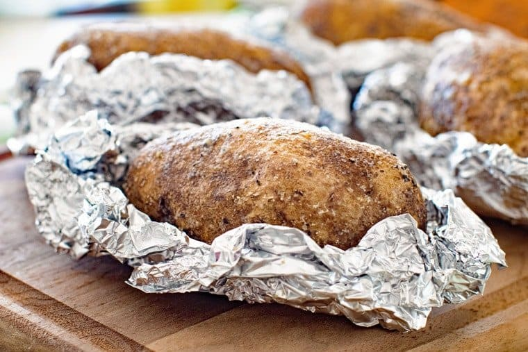 Grilled baked potatoes in tinfoil