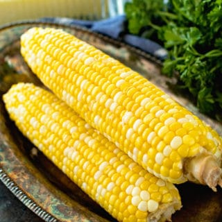 prepared grilled corn on the cob on a tray