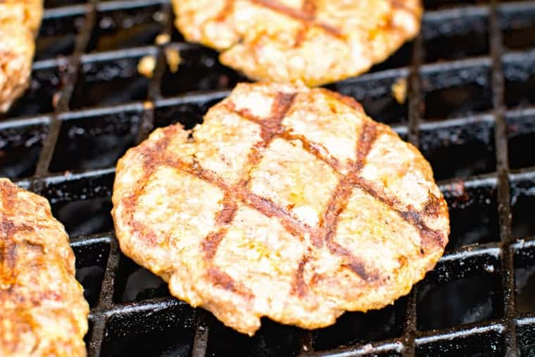 Hamburger on grill grates with sear marks