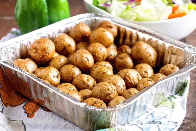 Smoked potatoes in foil pan