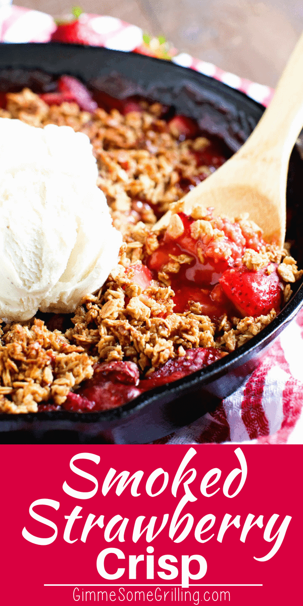 Strawberry Crisp. A cast iron skillet filled with baked strawberries with a crispy topping and a scoop of ice cream.