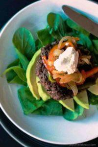 Skinny southwestern cheeseburger on spinach