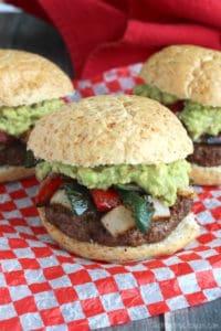 Grilled fajita burgers with guacamole on checkered paper