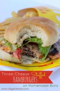 Three cheese stuffed burger and fries on wrapper