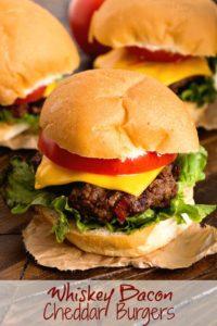 Whiskey bacon cheddar burgers on cutting board