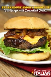 Steakhouse smokey barbecue beer burger with caramelized onions on white plate