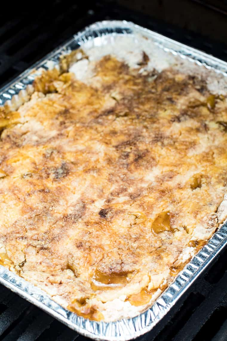 Apple Dump Cake Recipe on grill in aluminum foil cake tin