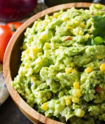 Corn guacamole in brown bowl