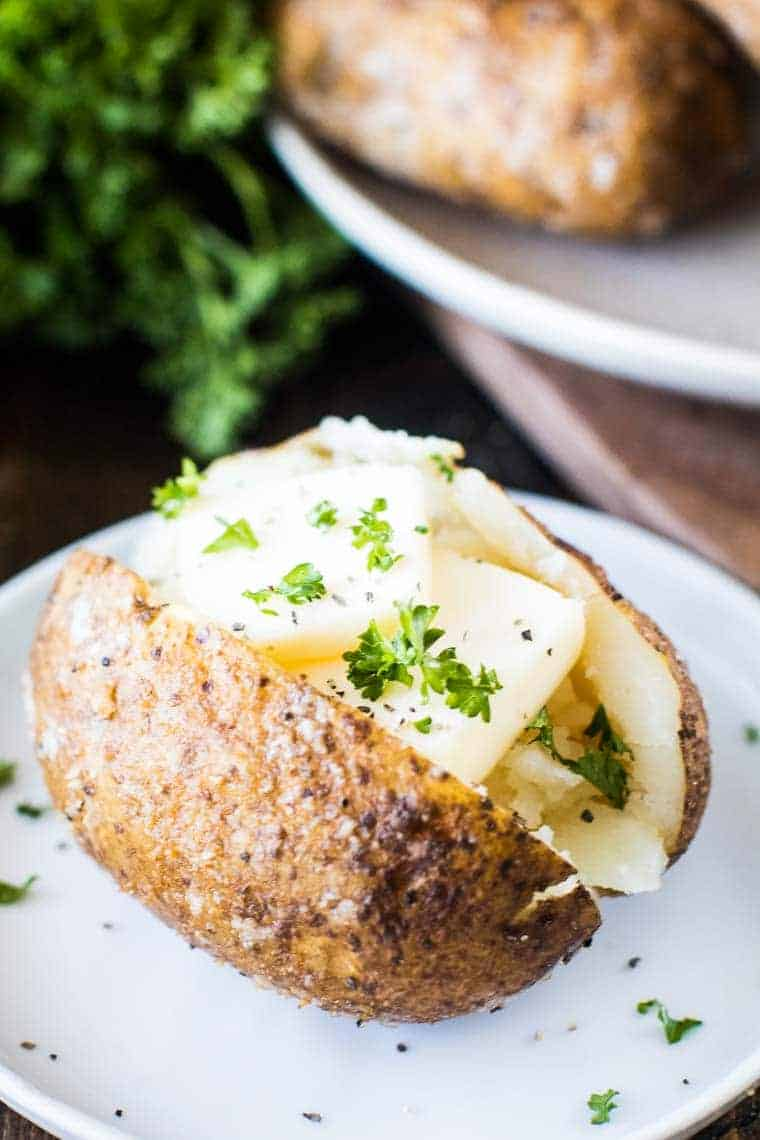 Smoked Baked Potato with butter on plate