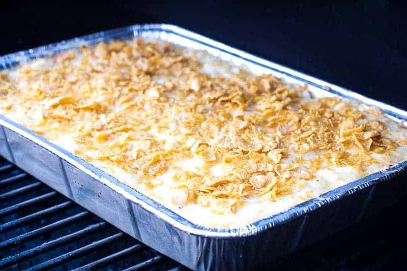 Pan of potato casserole on smoker grates
