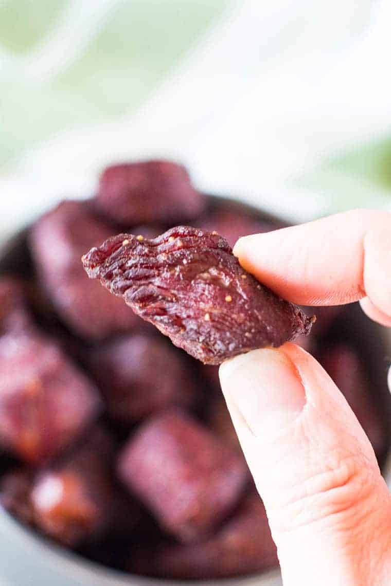 hand holding teriyaki steak bites