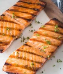 White plate with salmon on it