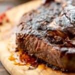 steak on brown platter marinaded