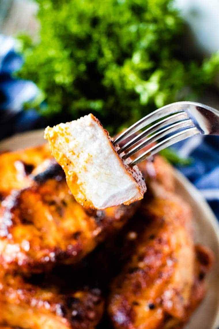 Grilled Boneless Pork Chops piece on fork