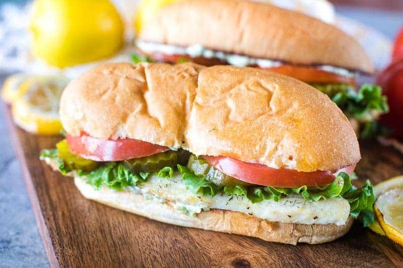 Grilled Walleye Sandwich on wood cutting board