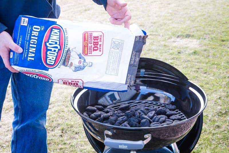 Kingsford Charcoal being poured into a grill