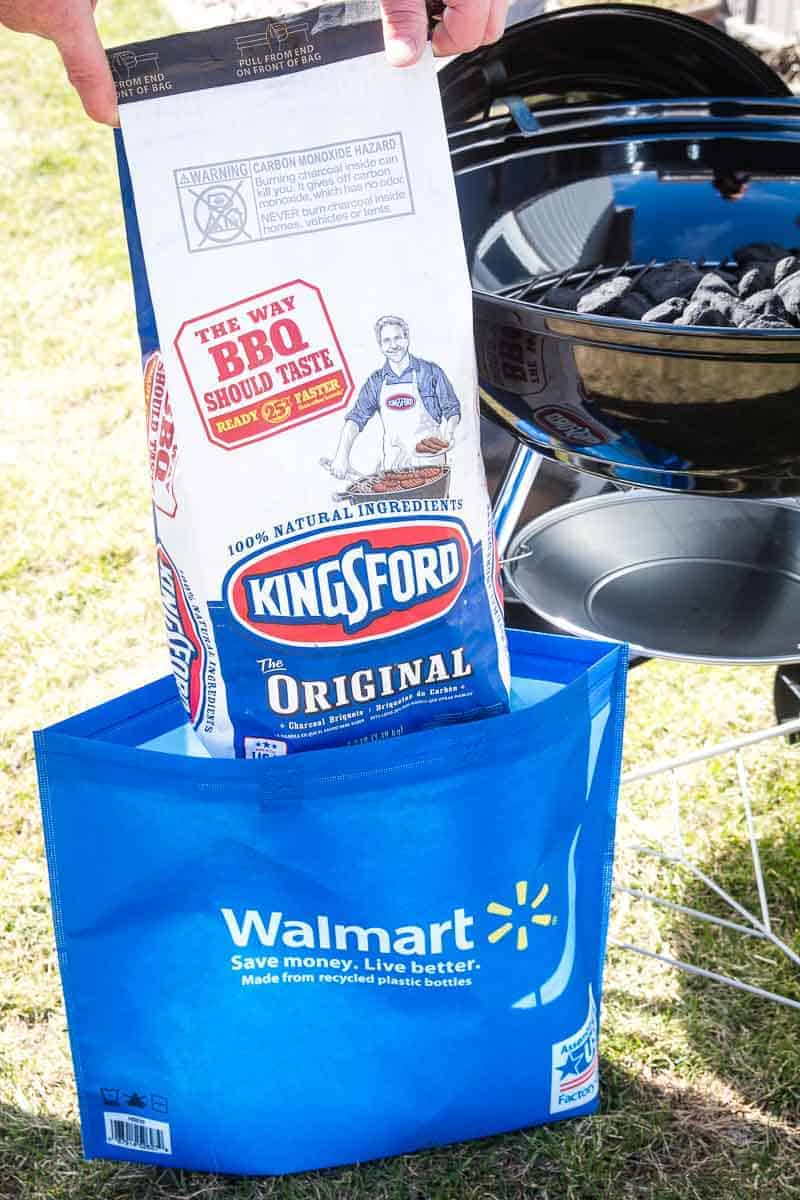 Kingsford Charcoal being lifted out of walmart bag