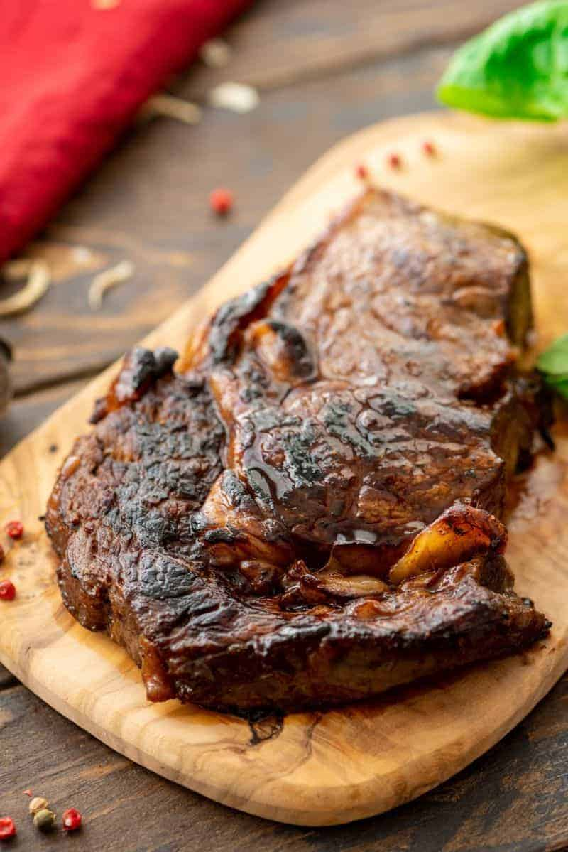 Steak prepared in marinade on wood platter