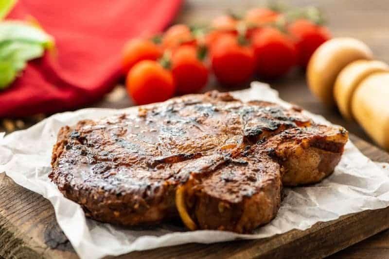 Steak laying on cutting board