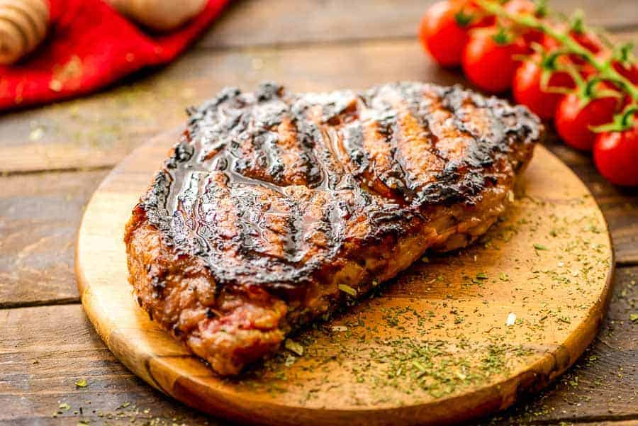 Grilled Italian dressing steak on cutting board