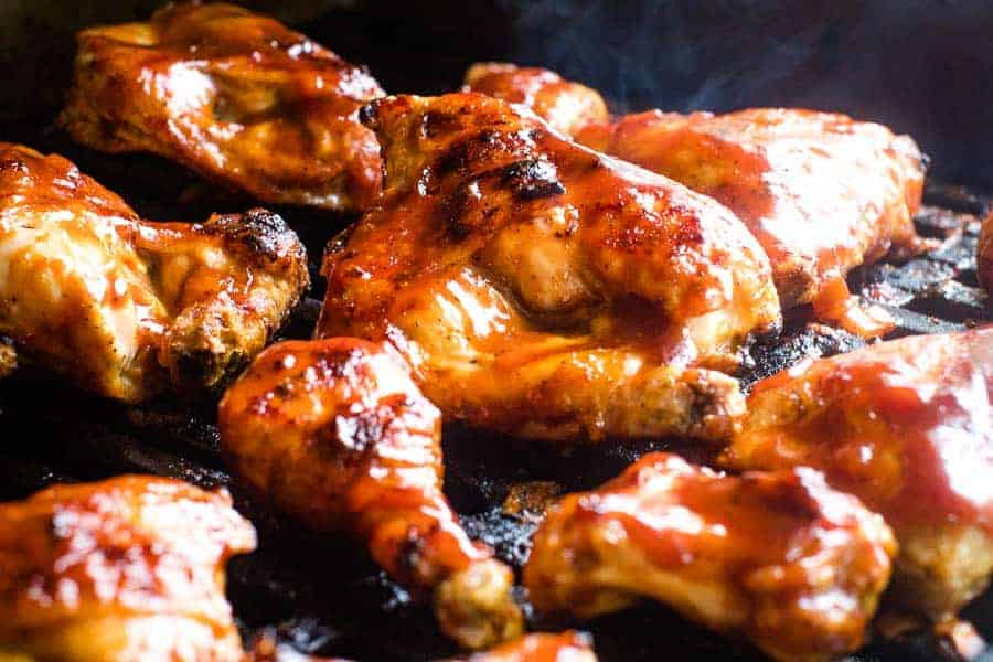 Grilled BBQ Chicken on grill