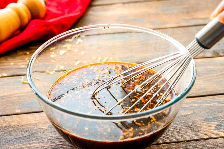 Marinade in bowl with whisk