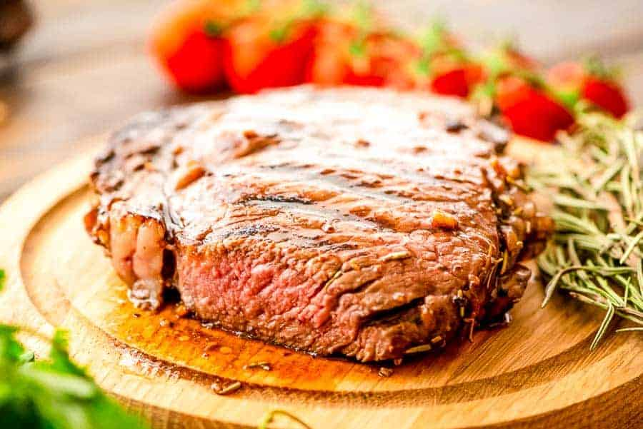Grilled balsamic Steak cut on board