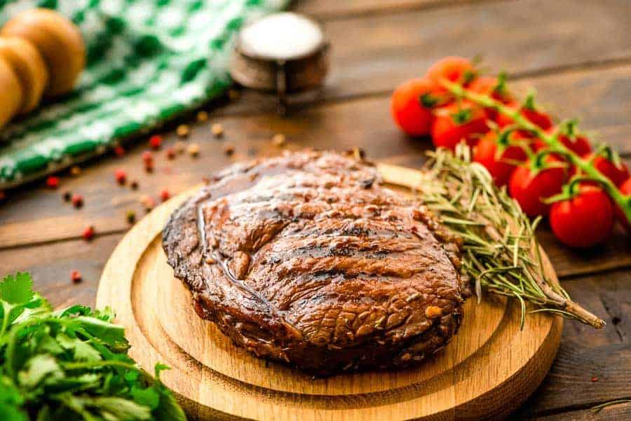 Balsamic Steak prepared in Marinade on cutting board
