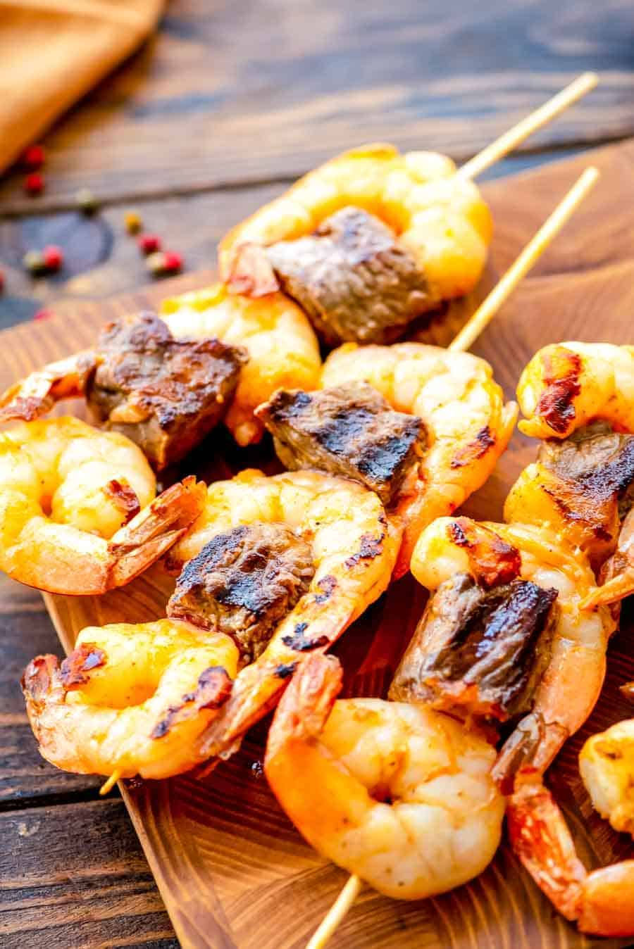 Grilled Steak and Shrimp Kabobs on cutting board