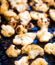 Grilled cauliflower on a black tray