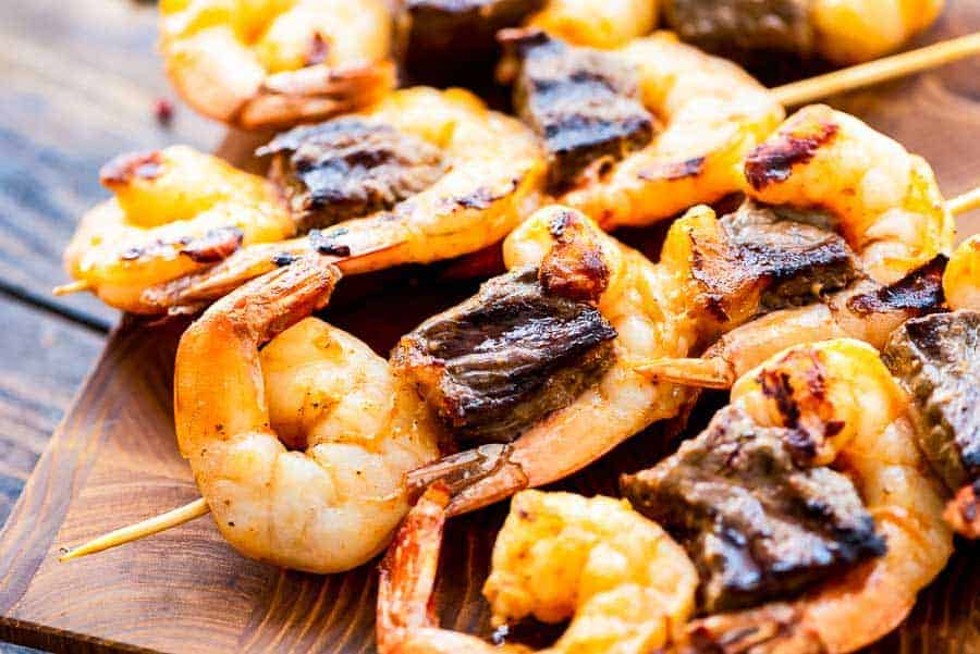 Steak and Shrimp Kabobs on cutting board
