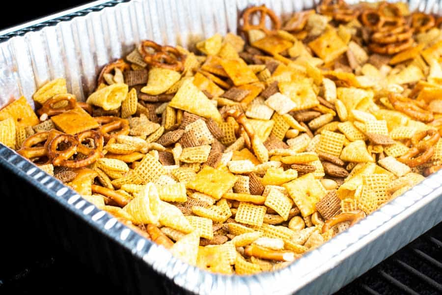 Pan of smoked snack mix on smoker