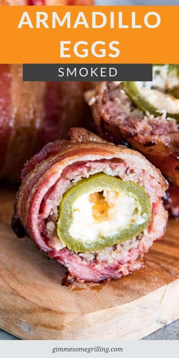 Smoked Armadillo Eggs are a delicious and easy smoker recipe that everyone will love. At the center is a jalapeno stuffed with cream cheese, then wrapped in sausage and bacon for a delicious addition. Make this for an appetizer or dinner! #smoker #traeger via @gimmesomegrilling