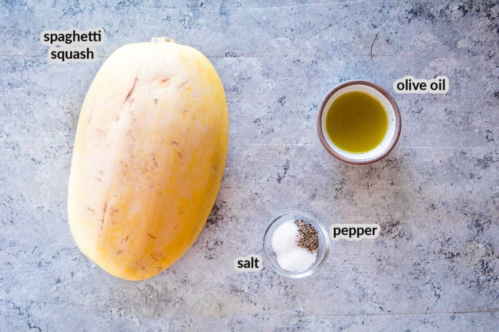 Ingredients for grilled spaghetti squash including a spaghetti squash, olive oil, salt and pepper.